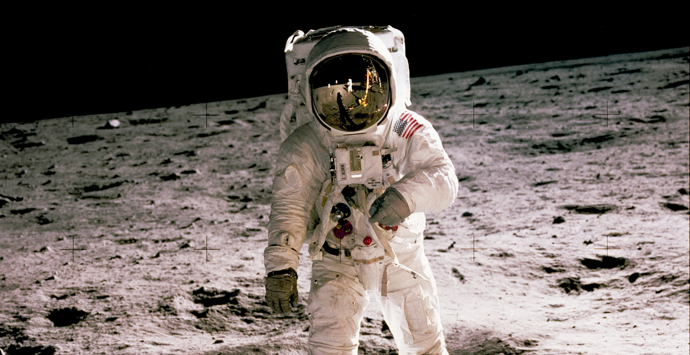APOLLO 11 ONBOARD: ASTRONAUT ALDRIN, EDWIN WALKING ON LUNAR SURFACE.